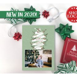 """Season's Greetings Banner Holiday Card. This holiday card features 2 of your favorite family photos with a """"Season's Greetings"""" banner in the middle. The banner is decorated with holiday boughs for a festive look. The message reads """"Season's Greetings Love XX Family""""."""